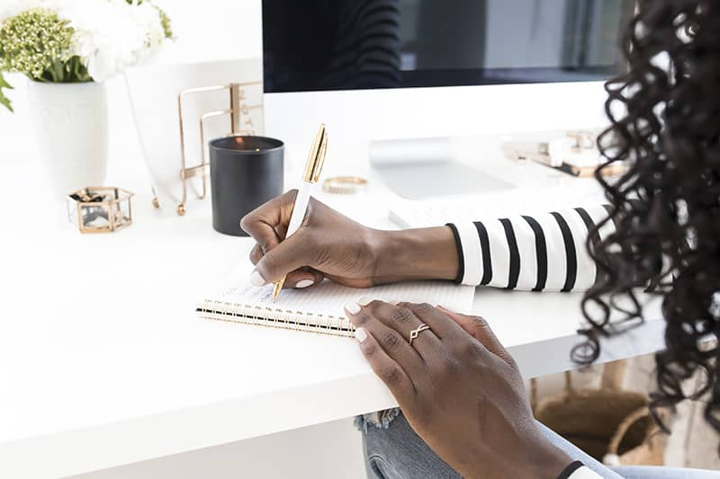 Styled Stock Photo Woman writing at desk